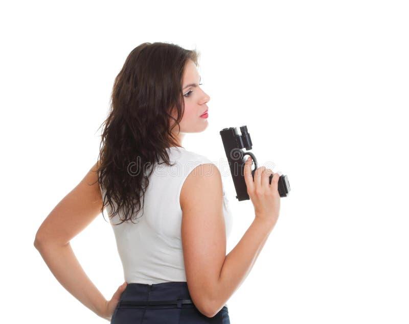 Jeune femme de brune avec le canon d'isolement sur le blanc image stock