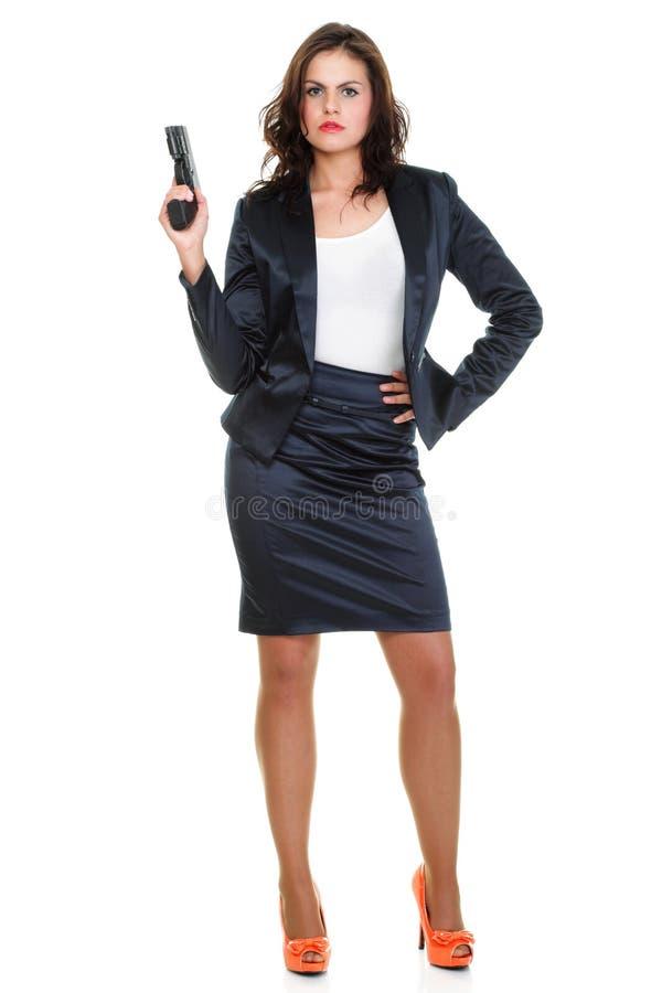 Jeune femme de brunette avec le canon d'isolement sur le blanc image stock
