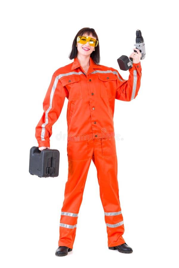 Jeune femme de constructeur avec un foret photo stock