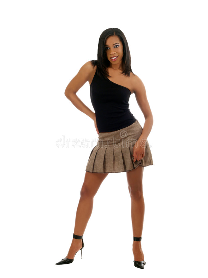 Jeune femme de couleur dans la jupe et le dessus images stock