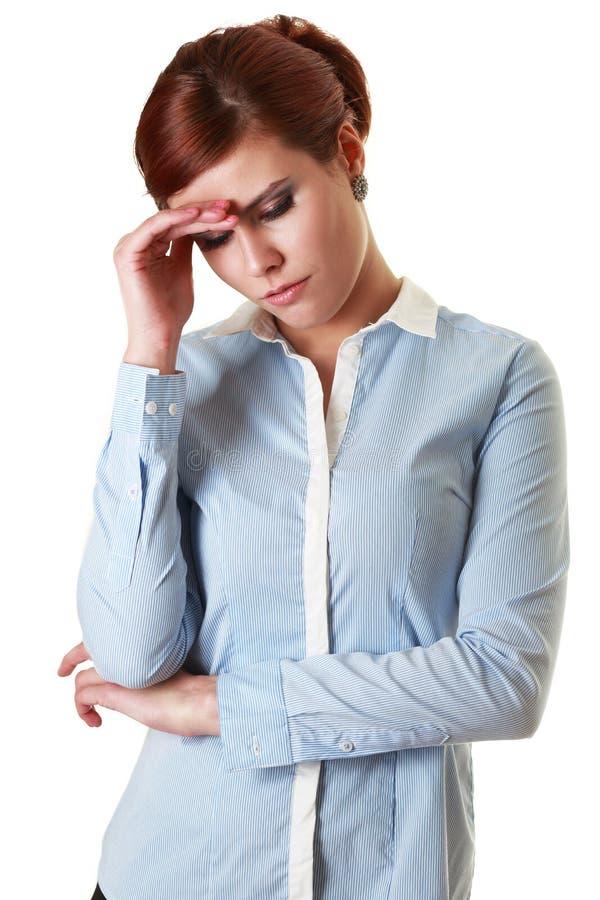 Jeune femme de mal de tête image stock
