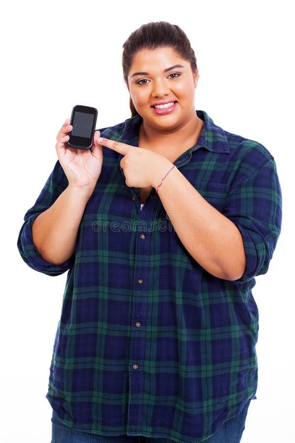 Téléphone intelligent de femme de poids excessif photographie stock