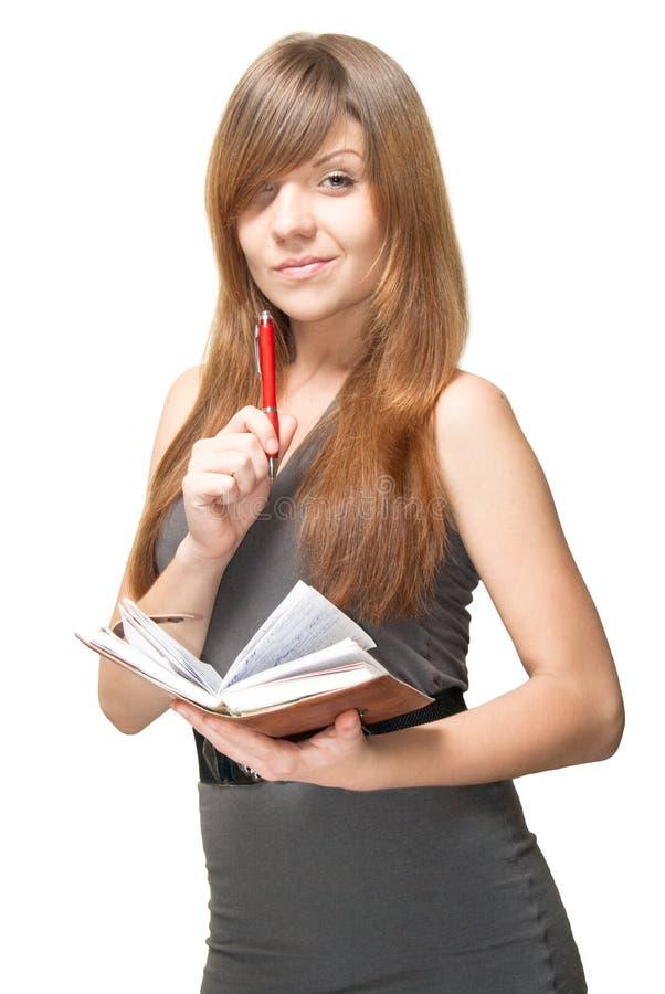 Jeune femme de sourire avec le crayon lecteur et l'agenda images libres de droits
