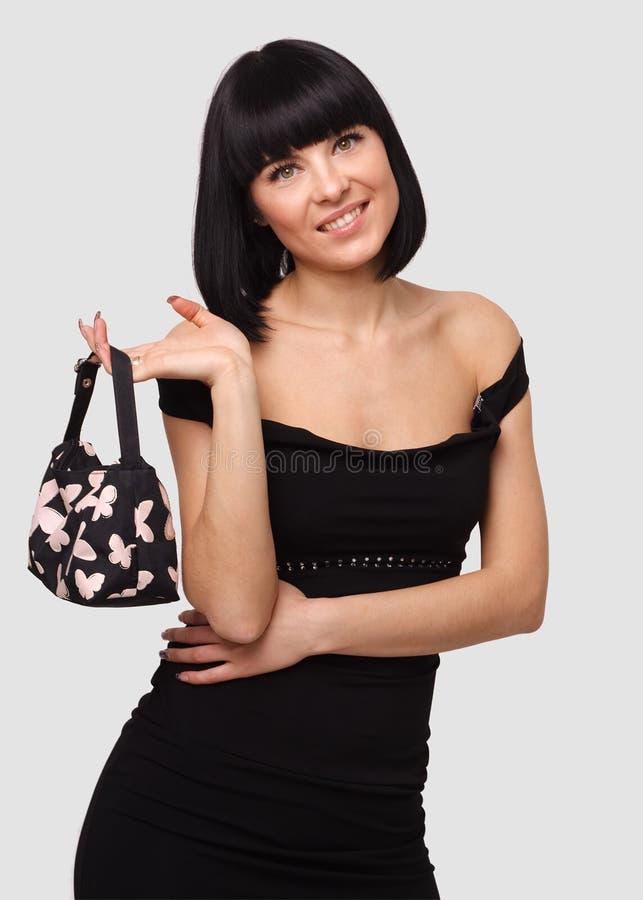 Jeune femme de sourire avec le sac à main photos libres de droits