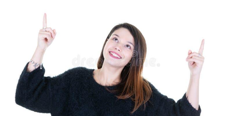 Jeune femme de sourire se dirigeant vers le haut de la recherche images libres de droits
