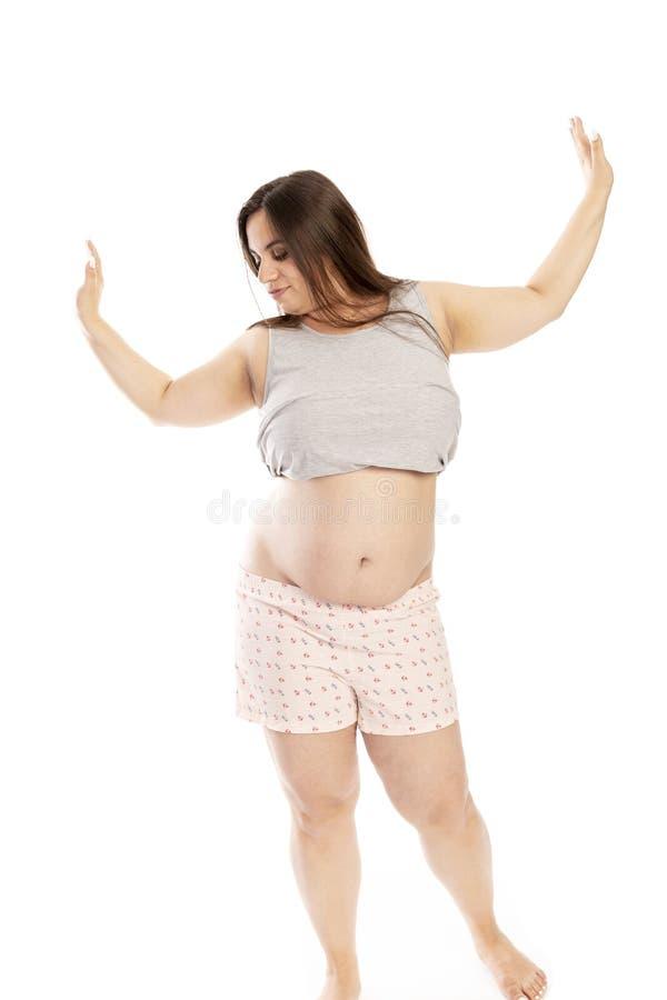 Jeune femme de Thik riant et dansing photos libres de droits
