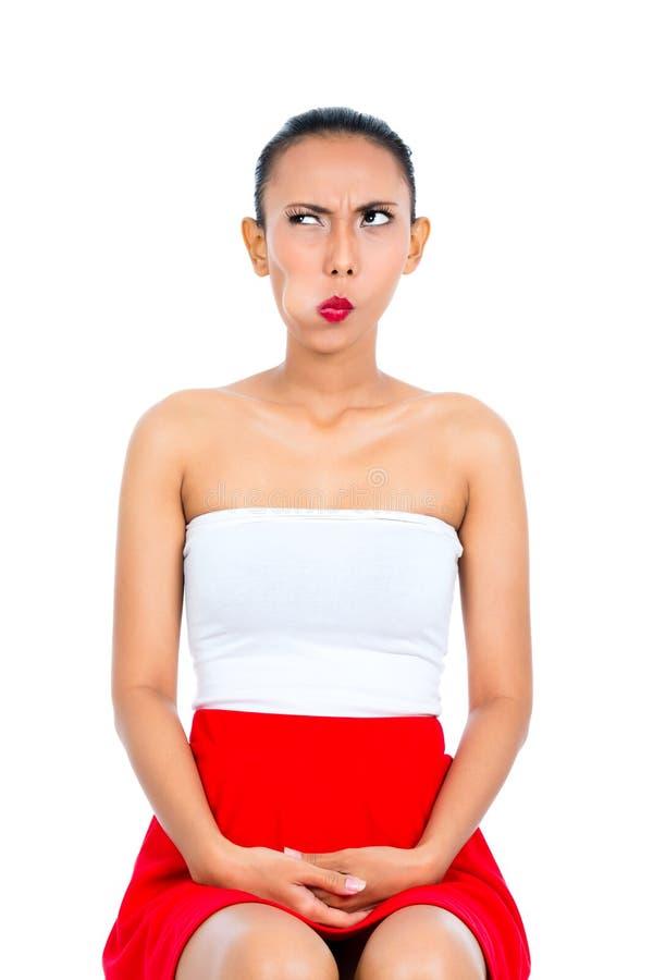 Jeune femme effectuant le visage drôle photo libre de droits