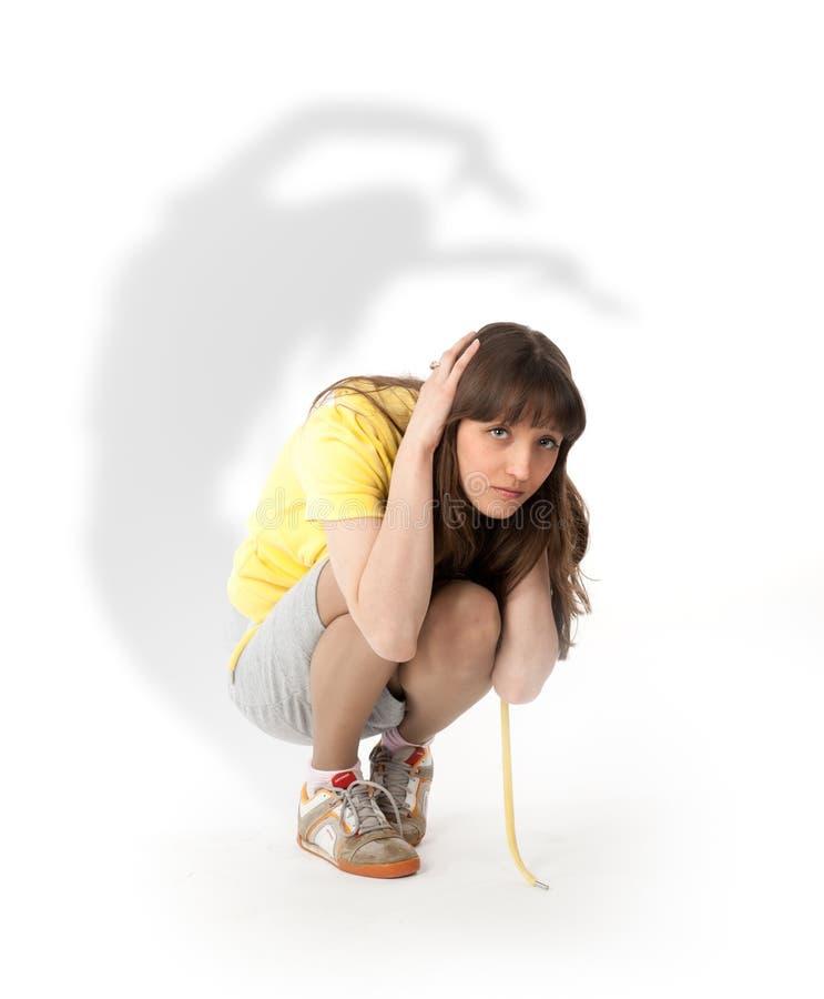 Jeune femme effrayée photographie stock