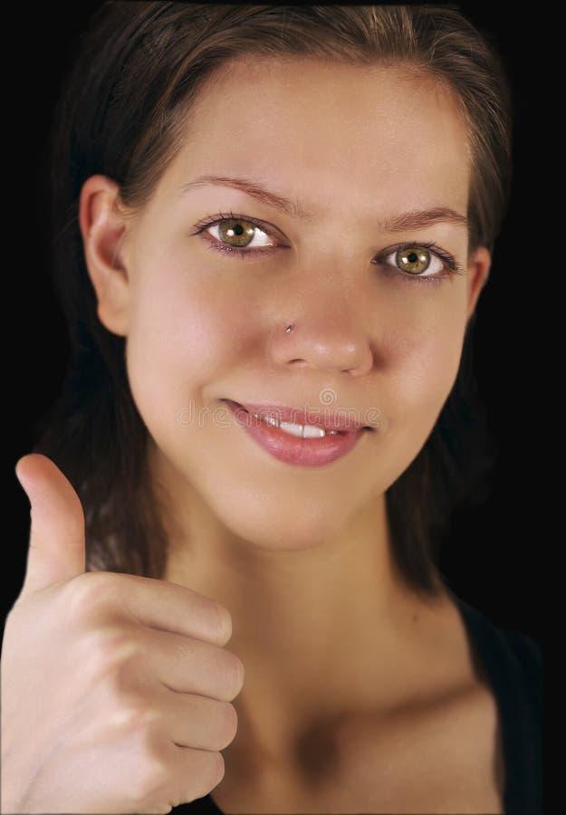 Jeune femme et pouce vers le haut photos stock