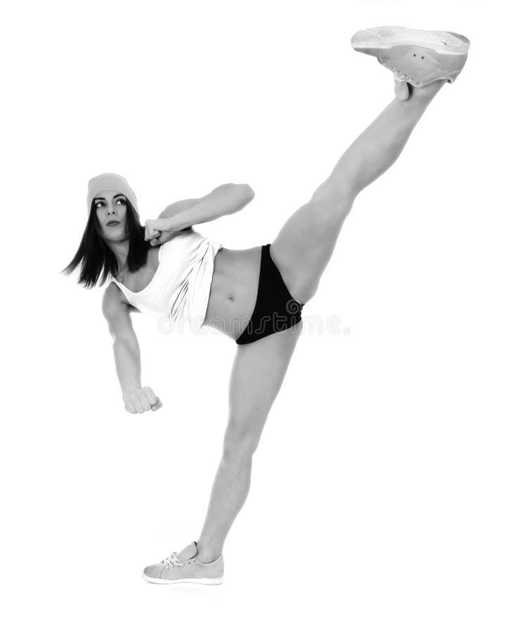 Jeune femme faisant des exercices de sport image stock