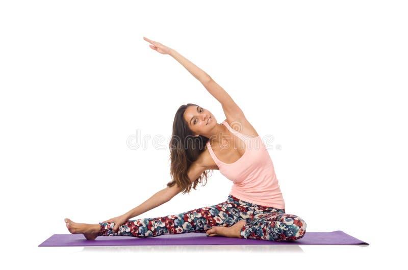 Jeune femme faisant des exercices de sport d'isolement image libre de droits