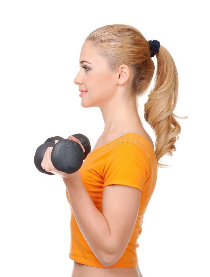 Jeune femme faisant des exercices gymnastiques photos stock