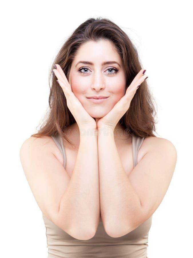 Jeune femme faisant la pose de yoga de visage photo stock