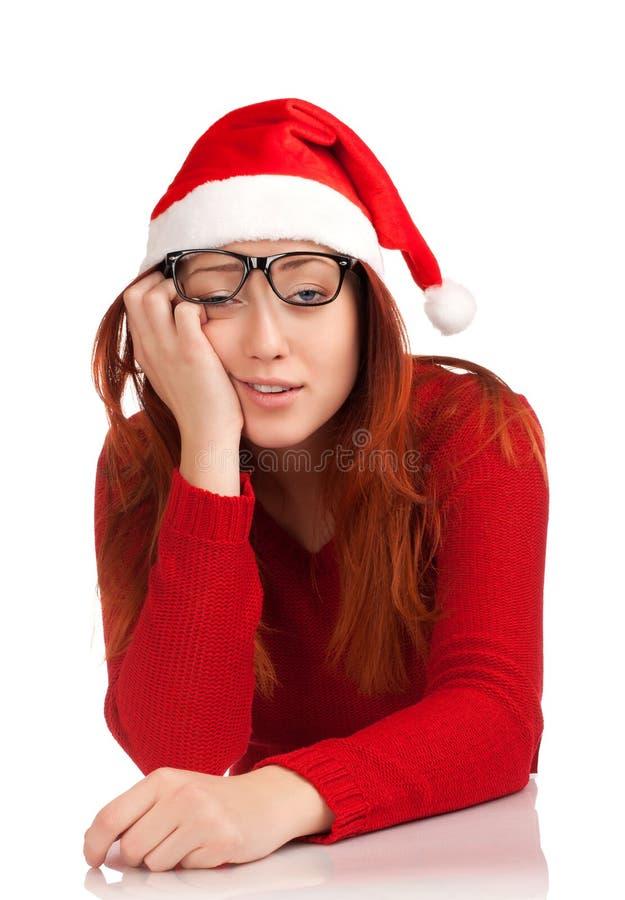 Jeune femme fatigué dans le chapeau de Santa image stock