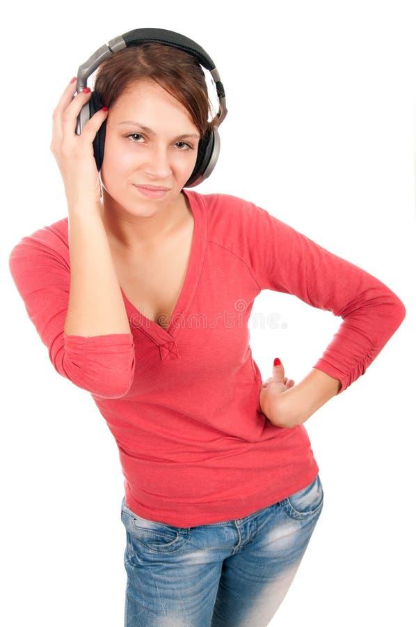 Jeune femme heureuse avec des écouteurs image libre de droits