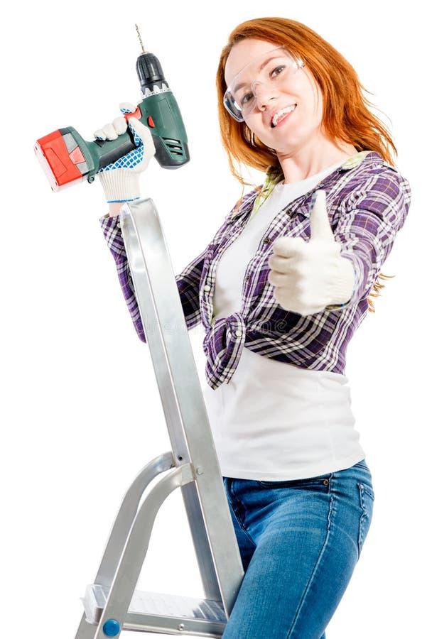jeune femme heureuse avec un outil sur un blanc photographie stock