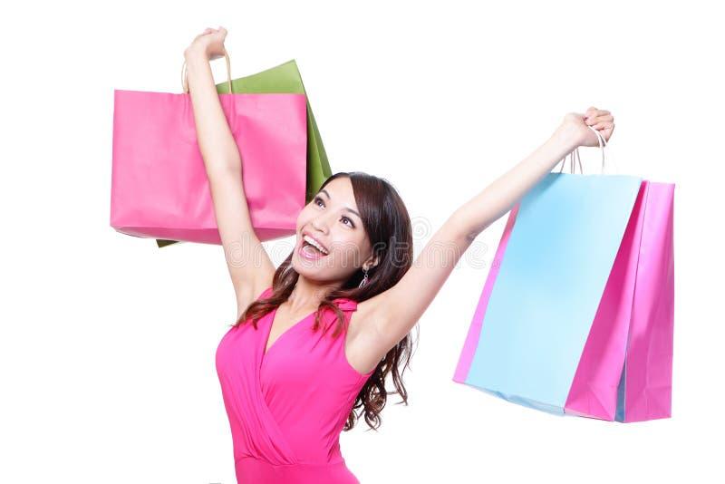 Jeune femme heureuse d'achats photo stock