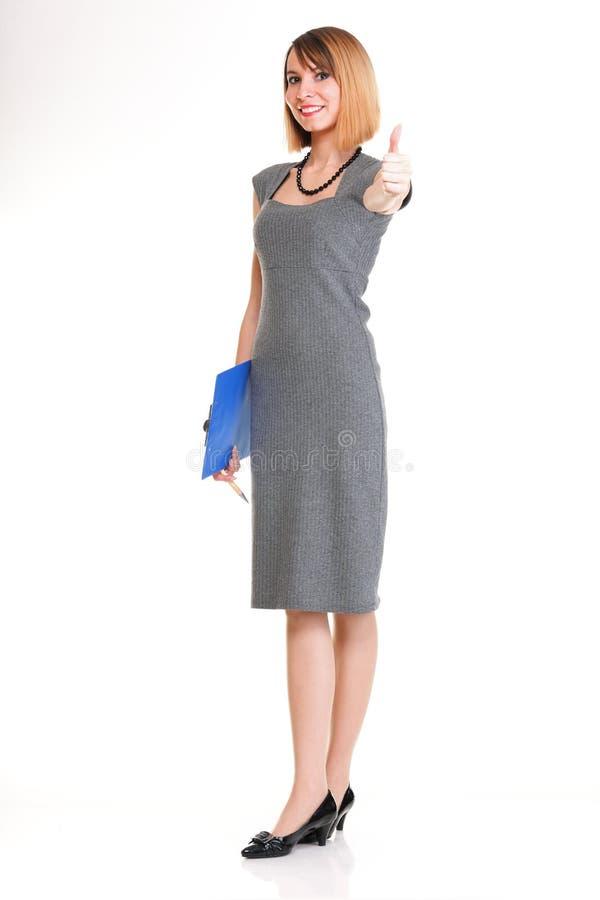 Jeune femme intégrale d'affaires restant avec son OIN de presse-papiers images stock