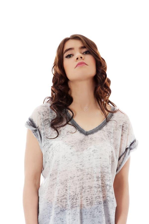 Jeune femme malheureuse avec de longs cheveux foncés photos stock