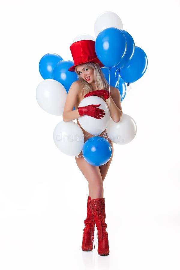 Jeune femme nu avec des ballons photo stock