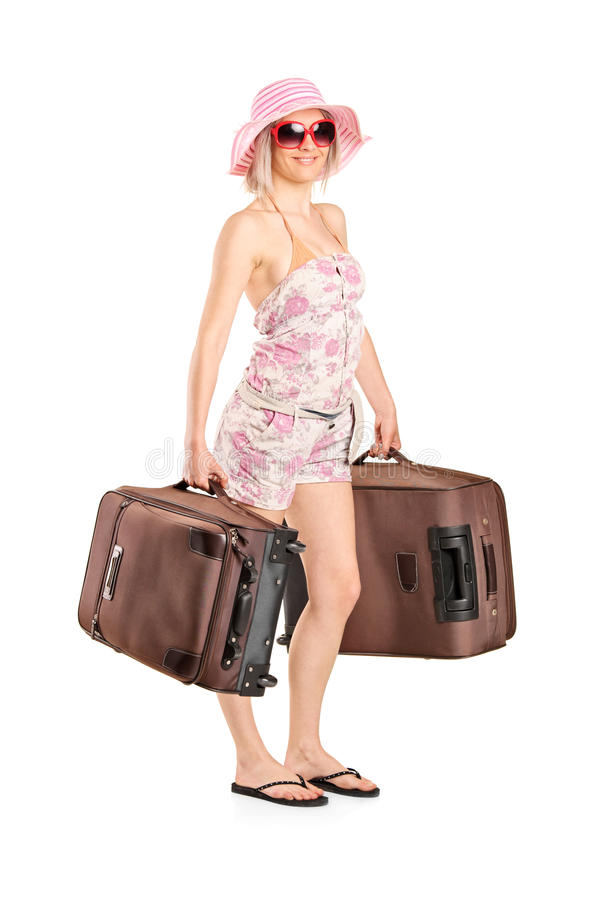 Jeune femme partant en vacances photos stock