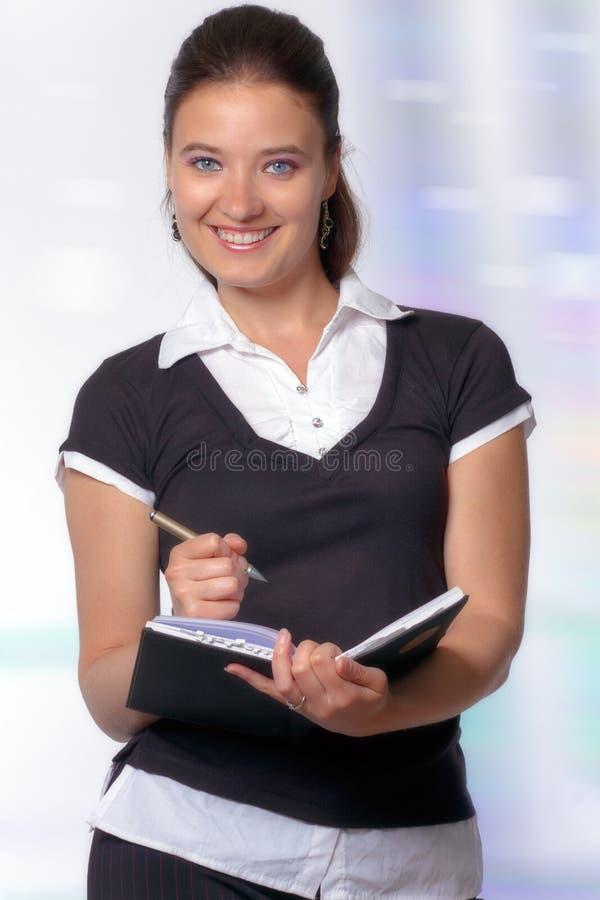 Jeune femme professionnel prenant des notes images libres de droits