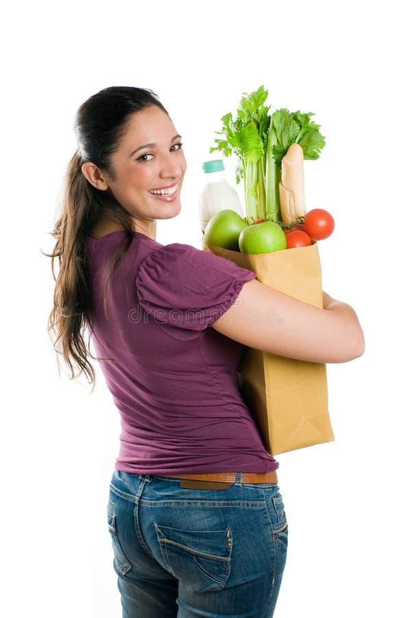 Jeune femme retenant un sac d'épicerie images stock