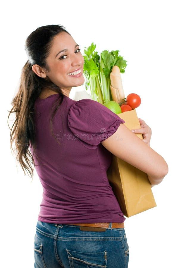 Jeune femme retenant un sac d'épicerie image stock