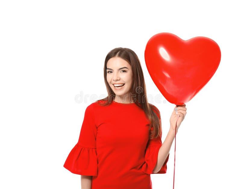 Jeune femme romantique avec le ballon en forme de coeur photo libre de droits