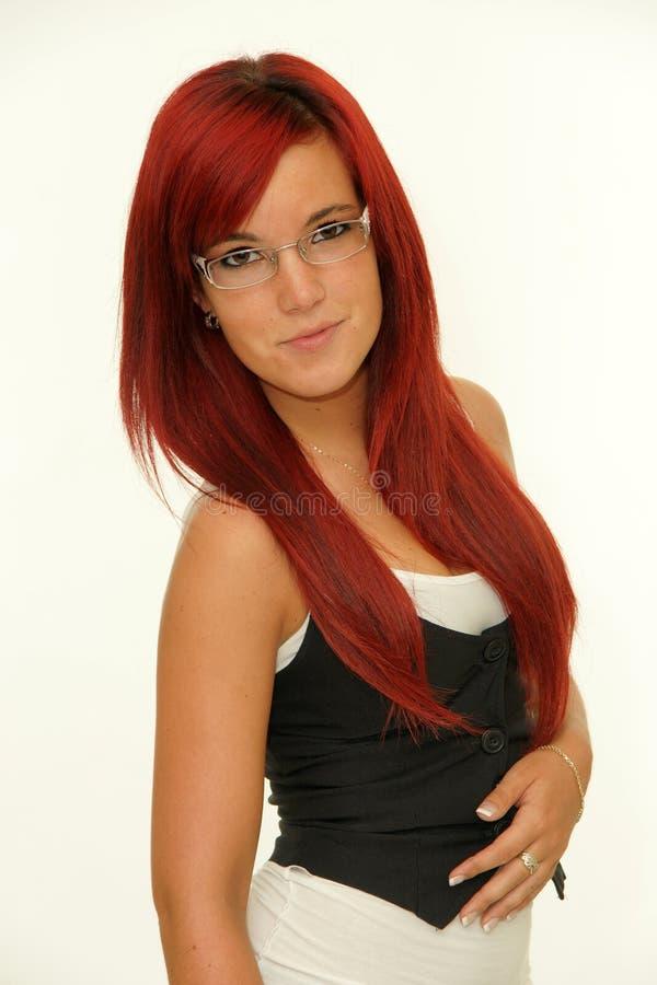 Jeune femme rousse avec des verres photos libres de droits