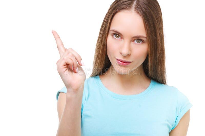 Jeune femme se dirigeant avec son doigt à l'espace de copie d'isolement photographie stock libre de droits