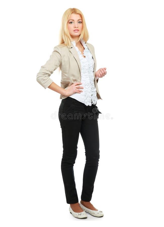 Jeune femme se tenant dans intégral d'isolement dessus photographie stock