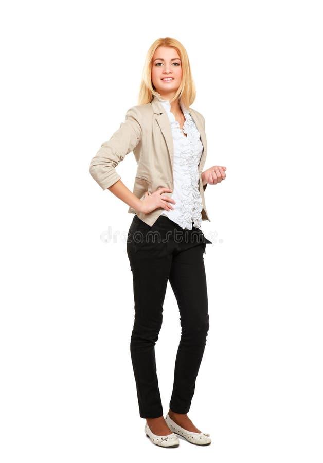 Jeune femme se tenant dans intégral d'isolement dessus images stock
