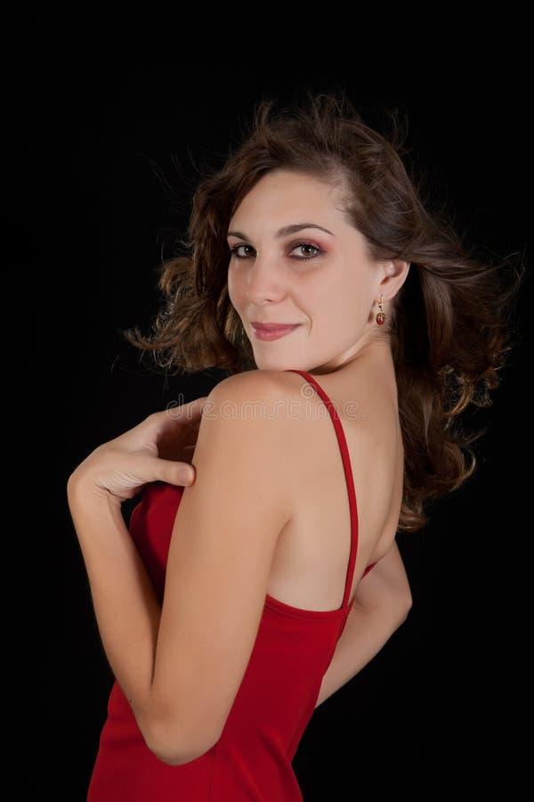 Jeune femme sexy dans la robe rouge. images libres de droits