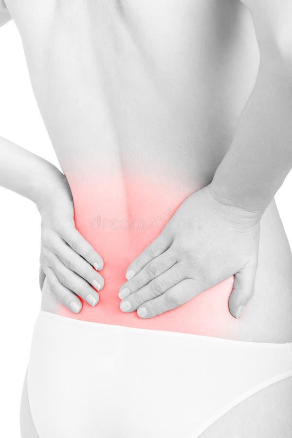 Jeune femme souffrant de la douleur dans un secteur rouge plus lombo-sacré sur le blanc photos stock