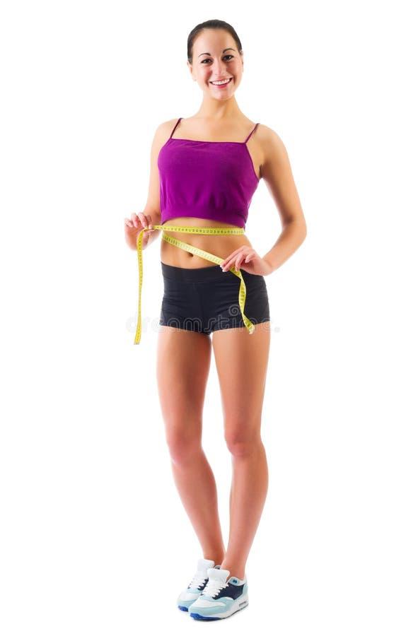 Jeune femme sportive avec la bande de mesure photo stock