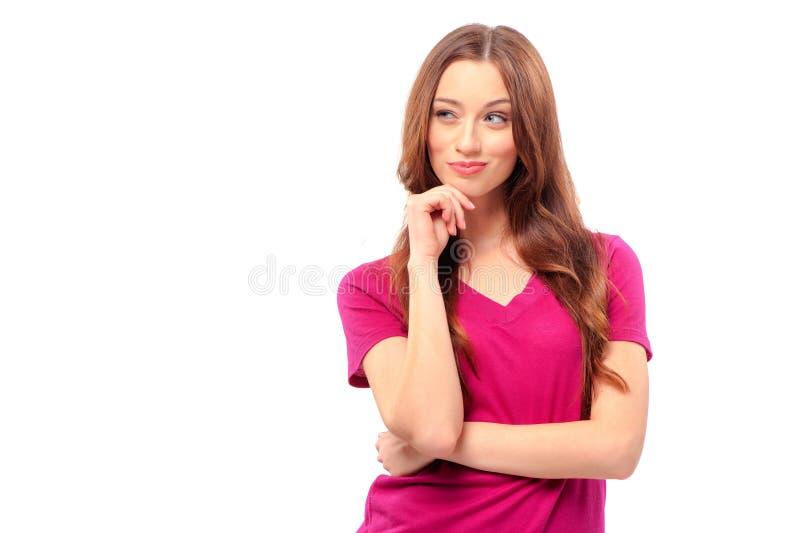 Jeune femme tenant la main sur le menton image stock