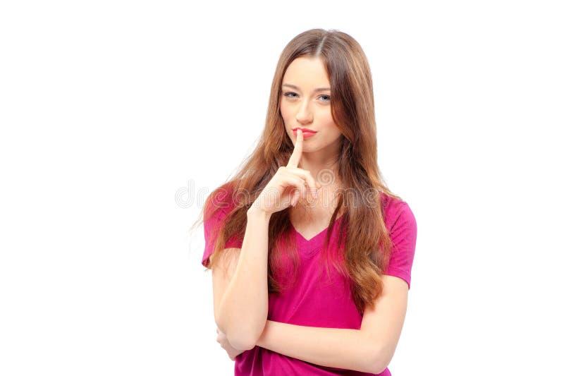 Jeune femme tenant le doigt sur des lèvres images stock
