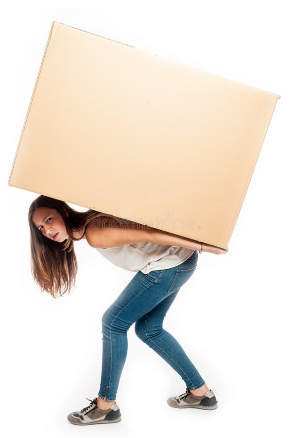 Jeune femme tenant un cardbox images stock