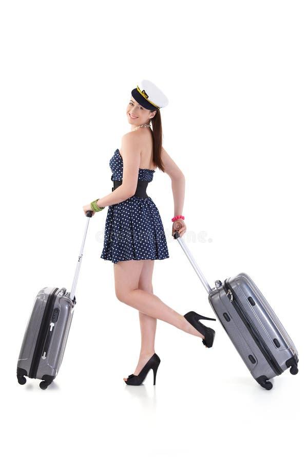 Jeune femme voyageant aux vacances avec la valise image libre de droits