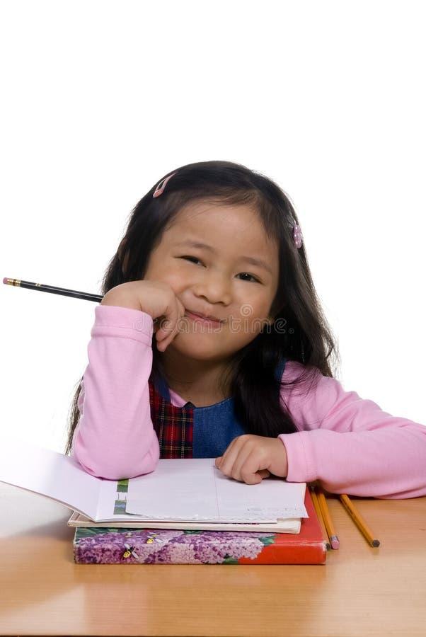 Jeune fille écrivant 4 photographie stock libre de droits