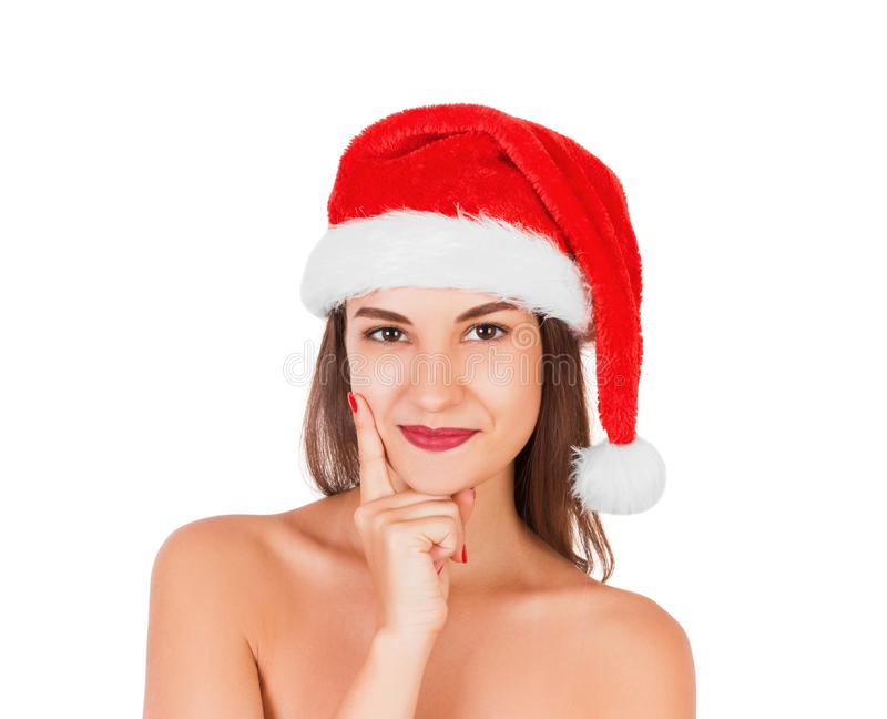 Jeune fille adulte avec le chapeau de port de Noël Sourire avec le visage réfléchi femme émotive dans le chapeau rouge du père no photographie stock