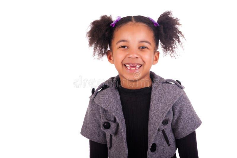 Jeune fille africaine sans dents image stock