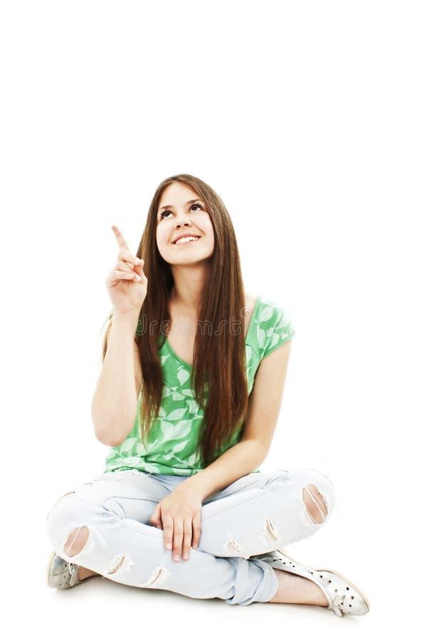 Jeune fille attirante se dirigeant avec le doigt images libres de droits