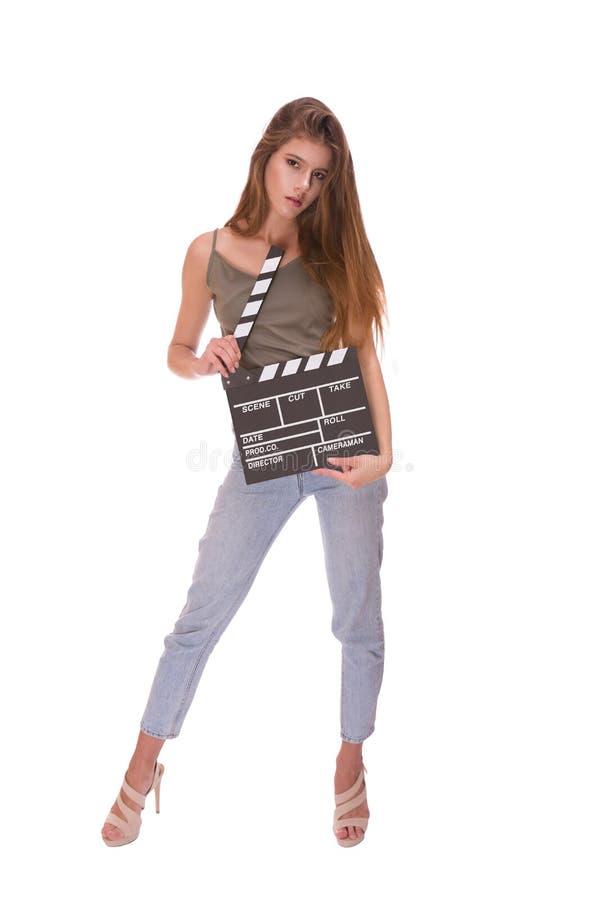 Jeune fille attirante tenant le panneau de clapet photos libres de droits