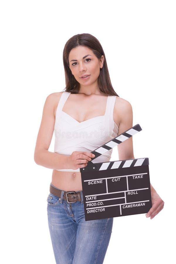 Jeune fille attirante tenant le panneau de clapet images stock
