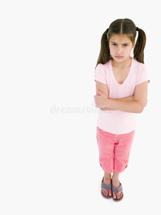 Jeune fille avec des bras croisés photo stock