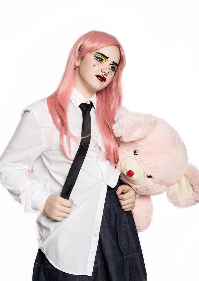 Jeune fille avec l'ours de nounours comique professionnel de participation de maquillage d'art de bruit Maquillage de bande dessi photographie stock libre de droits