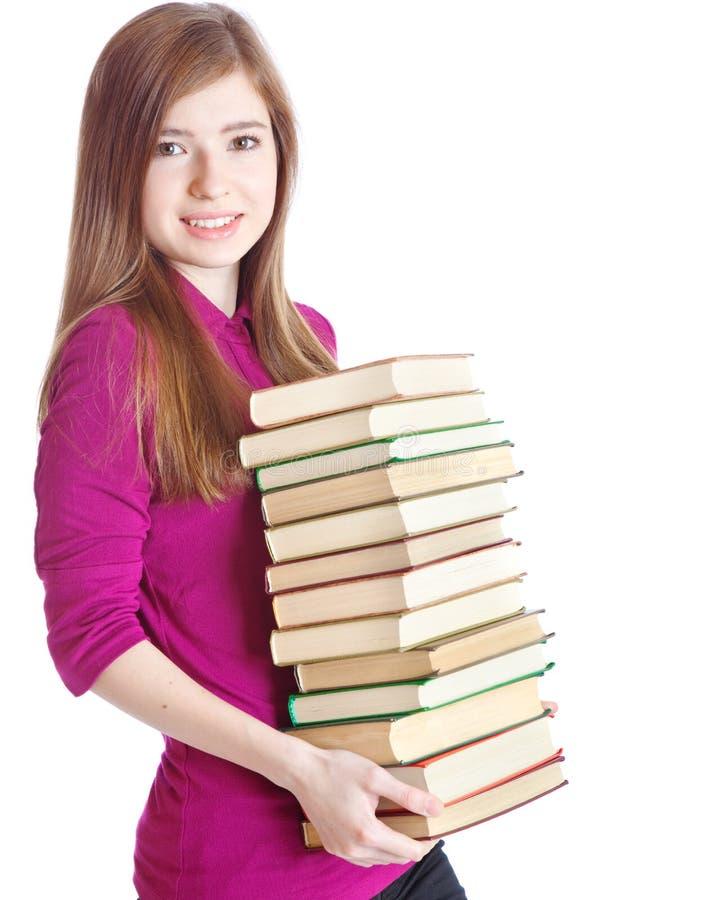 Jeune fille avec la pile des livres dans des mains photos libres de droits