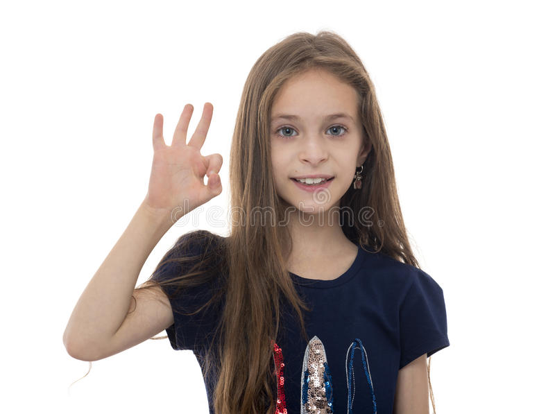 Jeune fille avec le geste CORRECT photographie stock libre de droits